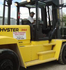 man driving yellow vehicle