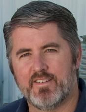 Eric Peter: Man with gray hair and beard